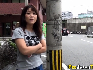 Asian pees a stream onto ride